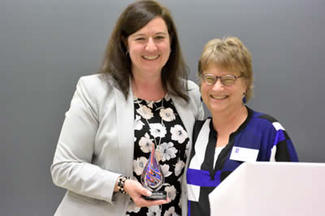 Carrie Grady receives award from Wendy Heller