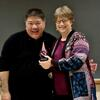 Loren Kuzuhara accepts the award from Wendy Heller, Professor & Head, Department of Psychology